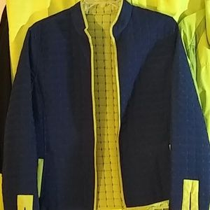Reverseable jacket. Blue and lime green. Large